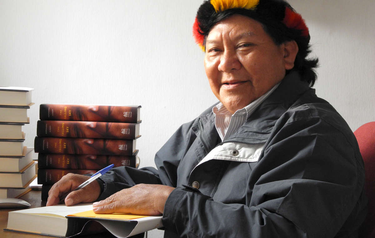 "Davi Kopenawa Yanomami, also known as the ""Dalai Lama of the Rainforest"" signs copies of his book _The Falling Sky - Words of a Yanomami shaman_"