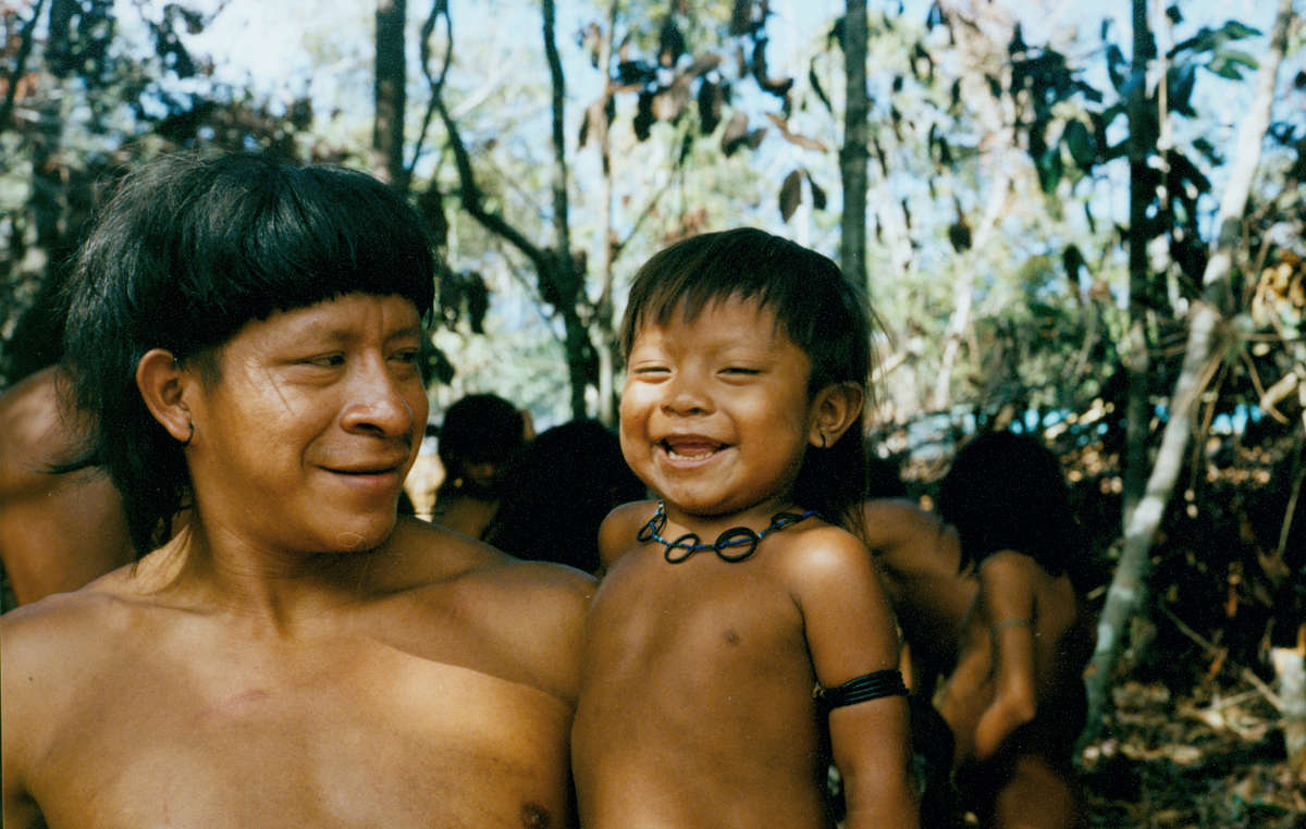 Enawene Nawe father and son, Brazil. The tribe opposes the building of 80 hydroelectric dams which would pollute the water and destroy the fish which are an essential part of their diet.
